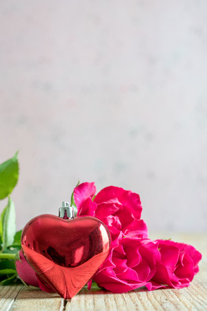 valentine`s day with roses and gift on wooden background