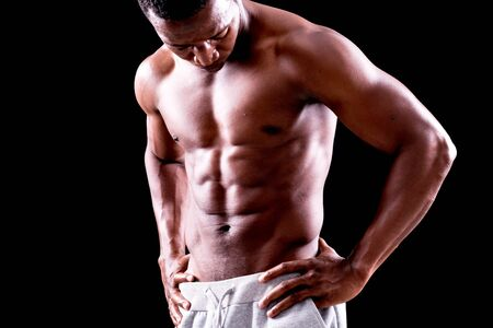 sixpack: Abs of a muscular man on black background