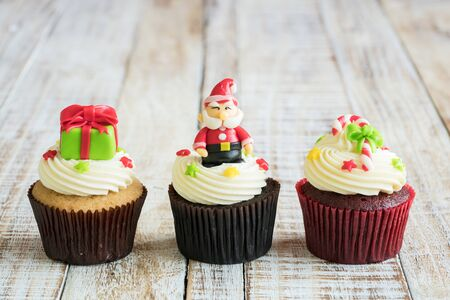 Christmas of cupcake on the old wooden.
