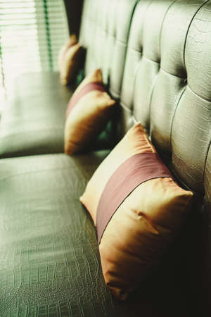 The pillow is located on the sofa, leaving space for the lettering.vintage filter effect