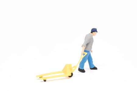 Miniature people delivery men worker concept on white background with a space for text