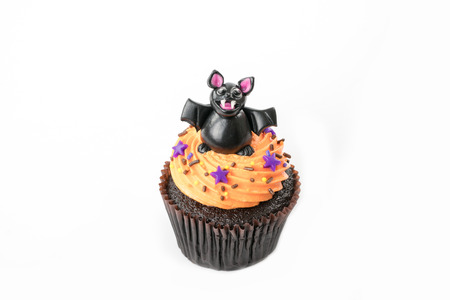 Variety of Halloween cupcakes on white background