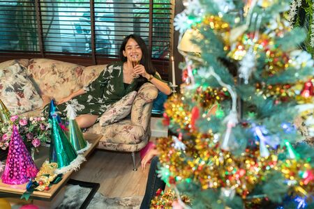 Asian woman waiting for christmas party.