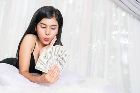 Young sexy female and dollar bills Stock Photo