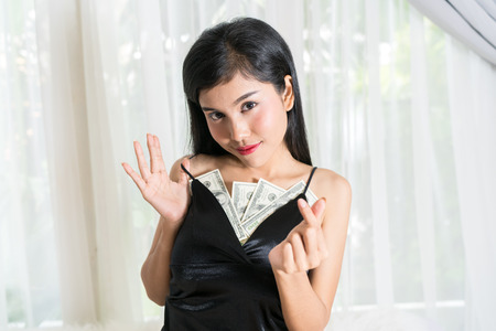 Young sexy female and dollar bills Archivio Fotografico