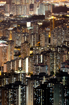 Urban cityscape skyline at night in Hong Kong