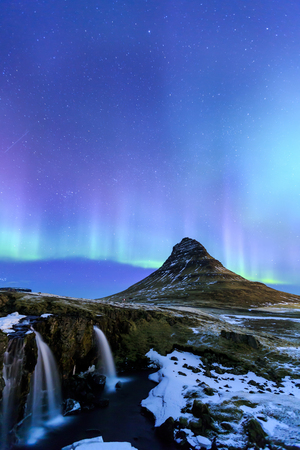 Mountain Kirkjufell and Aurora in Iceland. Stock Photo