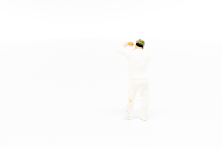 Miniature people Paint worker construction concept on white background with a space for text 写真素材