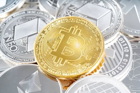 View close up of cryptocurrencies with a golden bitcoin, Litecoin, Ethereum. Blockchain technology.