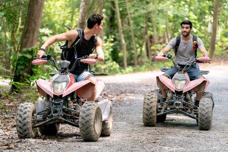 Atv riders speed race to journey through the jungle with Off-road atv car. Extreme sport is outdoor activity in the jungle.