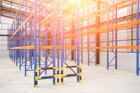Interior of Empty Big Huge Warehouse. New Large Scale Distribution Warehouse with High Empty Shelves.