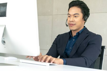 Young Male Technical Customer Support Operator Dispatcher Working with Headset in Center Office, Closeup