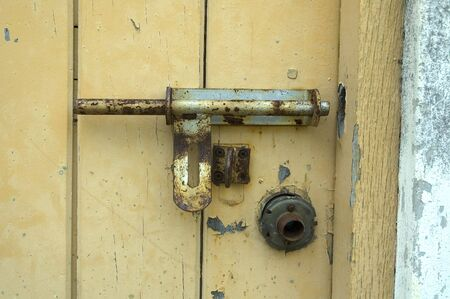 Old Door with broken Padlock photo