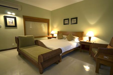 bedsheet: Hotel Room with Bed and Sofa