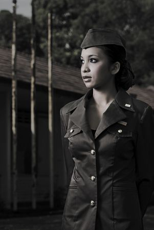 barrack: Female Army Personnel in an old barrack looking in a direction in vintage feel