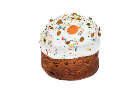 Christmas cake, sprinkled with icing and decorated with dried apricots, raisins and colored topping. Panettone isolated on white background.