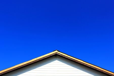 Roof and blue sky background.
