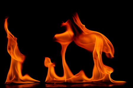 Beautiful fire flames on a black background. Stock Photo