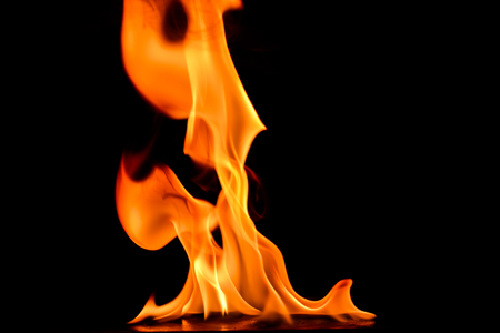 flammable: Beautiful fire flames on a black background. Stock Photo