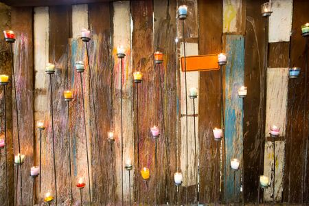 ratchaburi: Colored Candles with Wooden Wall Background - Ratchaburi, Thailand