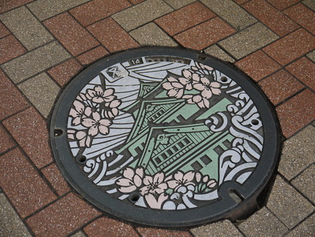 drainage cover at Osaka, Japan photo