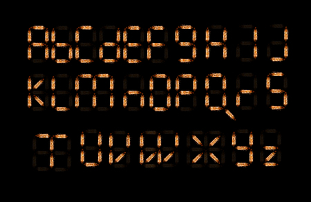 Alfabeto inglés hecho de agujas de bombilla aislado sobre fondo negro