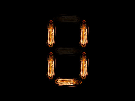 english alphabet U made of light bulb spires isolated on black background Foto de archivo