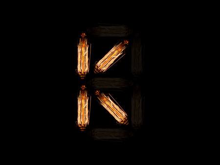 english alphabet K made of light bulb spires isolated on black background