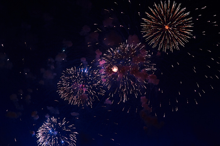 Inexpensive fireworks, over the city, red and blue . For any purpose