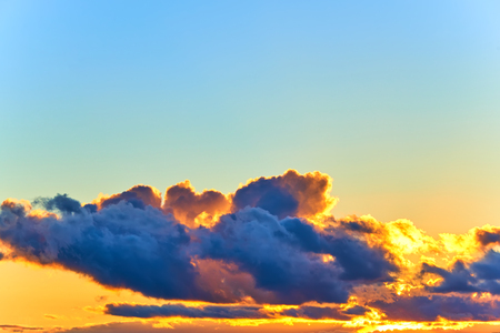 Beautiful clouds on the evening orenge and blue sky Stock Photo