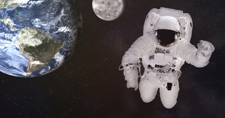 Single giant astronaut in outer space near Earth planet and moon of solar system with reflection in helmet. Science fiction 写真素材