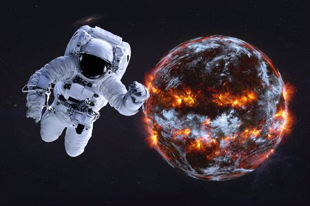 Astronaut near Planet Earth explosion in the outer . Humanity end. Planetary death concept. Elements of this image were furnished by . Stock Photo
