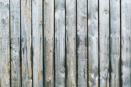 Old grey wooden plank fence background texture