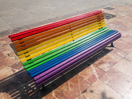 A bench painted in the colors of the rainbow. A place for sexual minorities. The concept of sexual equality and freedom. LGBT themes.
