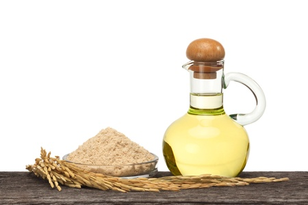 Rice bran oil in bottle glass with seed and bran on the old plank wood Stok Fotoğraf - 21479233
