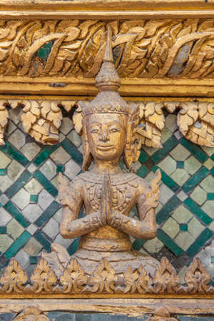 view of a wooden doorway: Wood carved and gilded decorative arts in Thailand temple