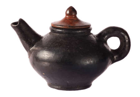 Pottery teapot traditional style on white background photo