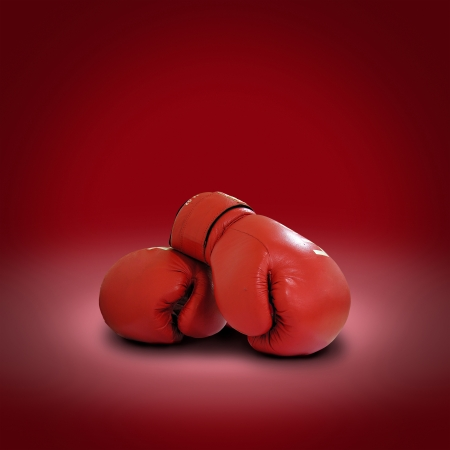 leather glove: Boxing gloves on red background
