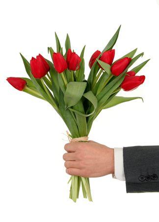Mano Que sostiene Las Flores Foto de archivo
