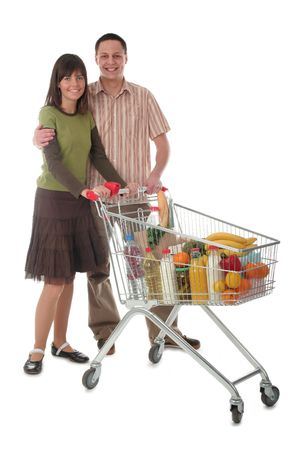 supermarket trolley: Couple with shopping cart Stock Photo