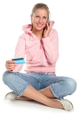 Girl with credit card and mobile phone photo