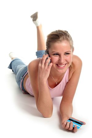 Girl lying with credit card and mobile phone photo