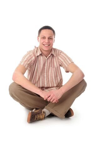 Young man sitting photo