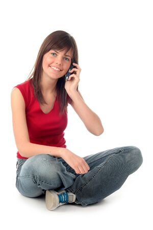 Girl using a mobile phone photo