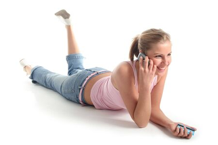 Girl lying with credit card and mobile phone Stock Photo - 414576