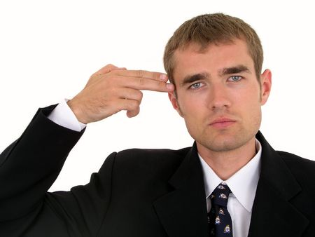 Businessman holding his hand to his head, mimicking a gun photo