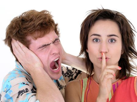 Man Screaming and Woman Making Silence Gesture photo