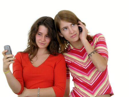 Two girls using mobile phones Stock Photo - 469091