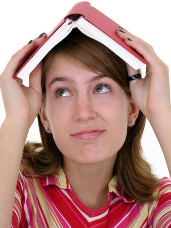 Girl holding book on head Stock Photo - 469078