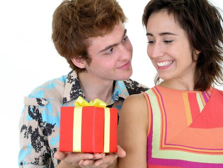 Young Man Offering Present to Girlfriend photo